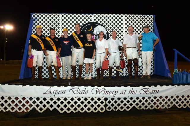 Polo players pose after a friendly Army-Navy match during military appreciation night at Great Meadow park in The Plains, Va., June 29, 2013. From left to right are: Mark Gillespie (Army major, retired); Tim Gray (former Army private); Clayton Kiyonaga (son of John Kiyonaga); John Kiyonaga (retired major, Army Reserve); Catherine Kiyonaga (daughter of John Kiyonaga); Vicky Friedrichs (U.S. Navy); Nicholas Place (former Marine Corps captain); Steven Walsh (retired Marine Corps lieutenant colonel); John Gobin (Director of Polo at Great Meadow Polo Club).