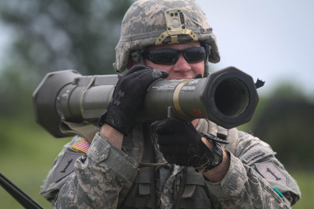 "First Lt. Sean Fitzpatrick, a platoon leader in Co. C, 1st Bn., 28th Inf. Regt., 4th IBCT, 1st Inf. Div., fires a simulated AT4 rocket launcher at an enemy position during Expert Infantry Badge testing hosted by the ""Dragon"" Brigade on June 27 at Fort Riley. Operating the AT4 correctly was just one of the more than 30 individual tasks infantrymen had to complete while taking part in the in the grueling testing."