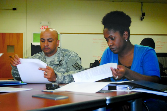 A DA civilian and a Soldier train with Army Logistics University cadre on course instruction at Fort Lee, Va.