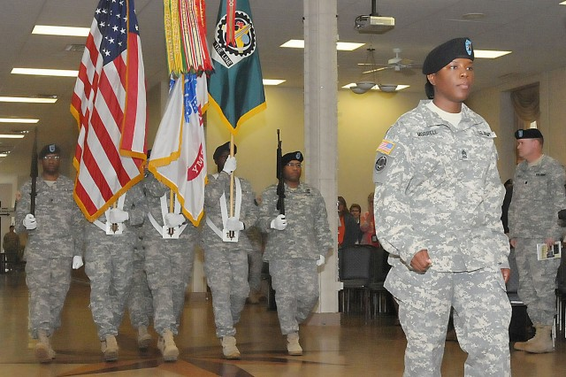 Master Sgt. Laketta Morrell, commander of troops, leads the color guard to the ceremony area in Heritage Hall June 27. Morrell serves as the ASC Distribution Integration Division noncommissioned officer-in-charge. (Photo by Jon Micheal Connor, ASC Public Affairs)