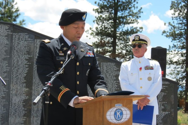 """Then-Redding Recruiting Co. Commander Maj. Jimmy Chen is keynote speaker at the Living Memorial Sculpture Garden Memorial Day event in Weed, Calif. Right, is Retired Navy Cmdr. Dean Whetstine, who was the Master of Ceremonies for the event. """"Some say you die twice,"""" said Chen in closing. """"The first time is when you stop breathing; the second is when somebody says your name for the last time.  May the legacy of those who made the ultimate sacrifice never be forgotten."""""""