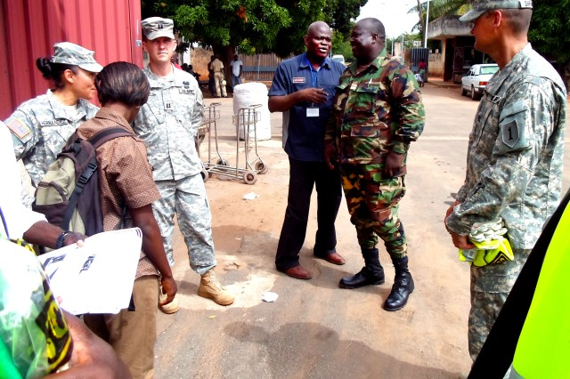 Sgt. Sonia Hernandez (upper left) assists Togo Defense Force troops during a practical exercise to determine the center of balance for vehicles. Hernandez and Capt. Aaron Shramek of the 299th Brigade Support Battalion, Fort Riley, Kan. along with Capt. Brad Copas of U.S. Army Africa traveled to Lome, Togo to provide African Deployment Partnership Training to Togo Defense Force personnel recently.
