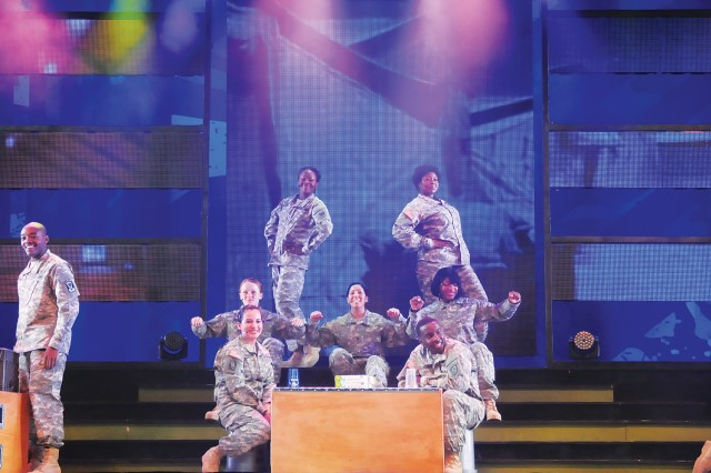 "Members of the 2013 Army Soldier Show, themed ""Ready and Resilient,"" use a sketch to convey messages during a performance at MacLaughlin Fitness Center June 27.The troupe performed two shows."
