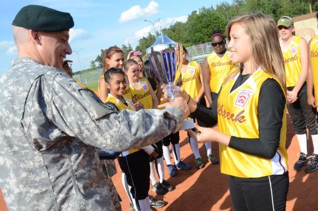 Thirteen-year-old Catherine Ferguson hands the BMC Little League softball team championship trophy to U.S. Army Garrison Grafenwoehr Commander Col. James Saenz, July 2.