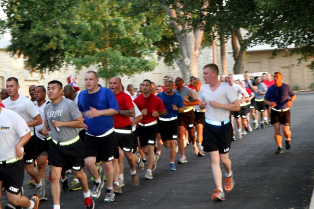 """FORT SAM HOUSTON, Texas """" The Soldiers of U.S. Army North (Fifth Army) run through the historic Quadrangle July 3 at the conclusion of an early morning run to celebrate the nation's Independence Day. As a show of patriotism, the Soldiers were encouraged to wear red, white or blue t-shirts."""