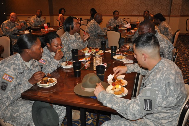 Soldiers enjoy complimentary food during the grand reopening of the NCO Club Friday.