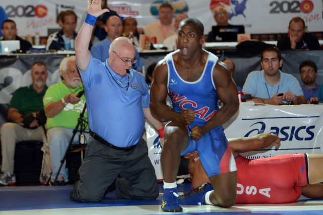 U.S. Army World Class Athlete Program wrestler and Colorado Army National Guard Spc. Caylor Williams, 22, a graduate of Palm Bay (Fla.) High School and the University of North Carolina at Greensboro, reacts to earning a berth in the 2013 FILA Wrestling World Championships after defeating New York Athletic Club's Marcus Finau in the 96-kilogram/211.5-pound Greco Roman division of the 2013 U.S. World Team Trials, June 22, 2013, in Stillwater, Okla.