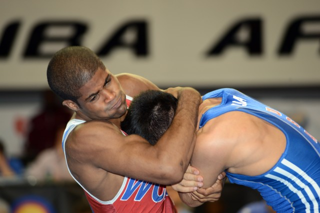 U.S. Army World Class Athlete Program wrestler Spc. Jamel Johnson (left) battles WCAP teammate Spc. Marco Lara in the 60-kilogram/132-pound division of the 2013 U.S. World Team Trials. Lara won the match, 5-3, and finished fourth in the tournament. Johnson came from Y.E.S. Wrestling and the University of North Carolina at Greensboro to join the Army WCAP Wrestling Team.