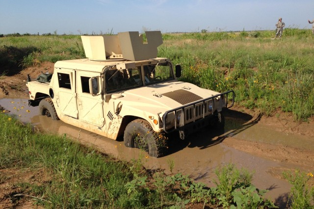 100th Brigade Support Battalion Soldiers faced the challenge of recovering a vehicle mired in mud during their four-day home station training, June 18-21 at Camp Eagle at Fort Sill, Okla.
