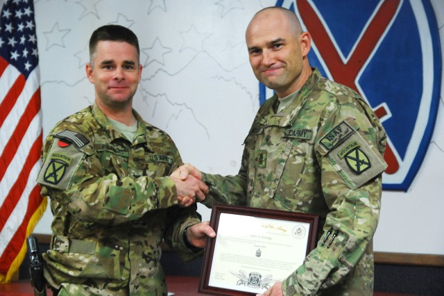 Col. David Francis, left, 10th Combat Aviation Brigade and Task Force Falcon commander, congratulates newly promoted Sgt. Maj. John Kolodgy after his promotion June 23 at Bagram Airfield, Afghanistan. Kolodgy has deployed with 10th CAB five times, including in 2003 when he was promoted to sergeant first class in the same building as his recent promotion.