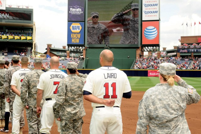 "Soldiers salute the flag Sunday while standing alongside Atlanta Braves and Arizona Diamondbacks players as the national anthem played during the pregame ceremony. The Atlanta Braves and Fox Sports South honored the military with its ""Tribute to the Troops."" The Braves went on to win the game 6-2."