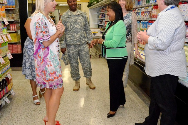 Melinda Riling and Linda Via enjoy their tour of the RIA Commissary. Rebekah Wharton and Col. Elmer Speights Jr., participated in the surprise-filled tour at the RIA Commissary. (Photo by Elizabeth Adolphi, ASC Public Affairs)