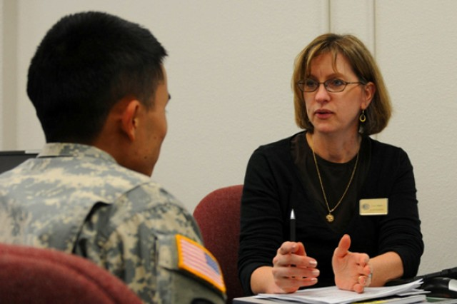 Army Career & Alumni Program counselor, Lori Mann offers guidance to a transitioning soldier at Joint Base Lewis-McChord.