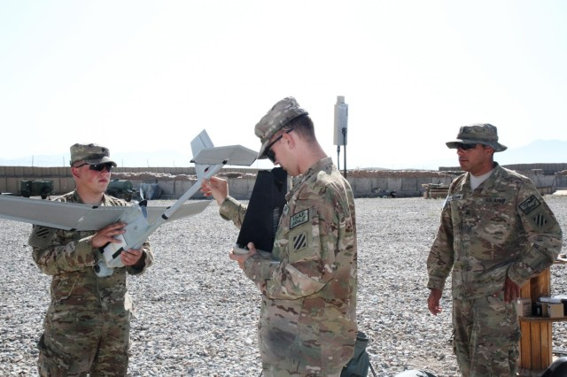 Spc. Nathan Santos (left), a native of Layton, Utah, and a wheeled vehicle mechanic, and Spc. Jonathan Hensley, a native of Ellijay, Ga., and a cavalry scout, both with Troop A, 6th Squadron, 8th Cavalry Regiment, 4th Infantry Brigade Combat Team, 3rd Infantry Division, conduct pre-flight checks on the Raven unmanned aircraft system before flying a training mission, while Sgt. Harold Wideman (right), a Baltimore native and a Raven unmanned aircraft system master trainer with Company C, 3rd Battalion, 15th Infantry Regiment, 4th IBCT, supervises the training, July 2, 2013, in eastern Afghanistan.