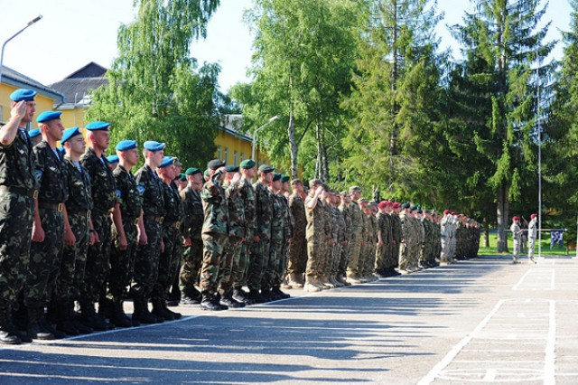 Soldiers from participant nations stand in formation, July 8, 2013, during the opening ceremony for Exercise Rapid Trident 2013, at the International Peacekeeping and Security Center in Yavoriv, Ukraine. Rapid Trident 2013 is a U.S. Army-Europe led, multinational field training and command post exercise occurring at the International Peacekeeping and Security Center in Yavoriv, from July 8 to July 19, that involves approximately 1,300 troops from 17 different nations. The exercise is designed to enhance interoperability between forces and promote regional stability and security.
