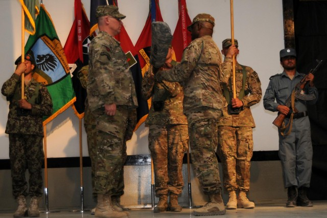 Maj. Gen. Paul J. LaCamera, 4th Infantry Division commanding general and incoming Regional Command (South) commanding general, and 3rd Infantry Division Command Sgt. Maj. Edd Watson, outgoing Regional Command (South) command sergeant major, uncase the Combined Joint Task Force-4 colors during the Regional Command (South) Transfer of Authority Ceremony at Kandahar Airfield, Afghanistan, July 8, 2013. The 4th Infantry Division assumed command of the region from the 3rd Infantry Division during the ceremony.