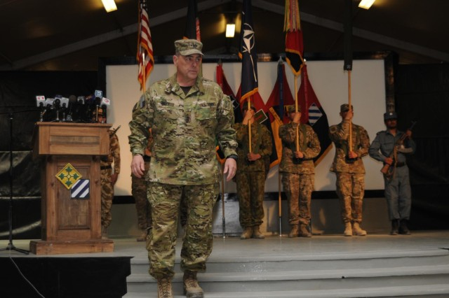Lt. Gen. Mark A. Milley, commanding general of International Security Assistance Force Joint Command, speaks to NATO force members, Afghan National Security Force members, and Afghan government officials during the Regional Command (South) Transfer of Authority Ceremony at Kandahar Airfield, Afghanistan, July 8, 2013.