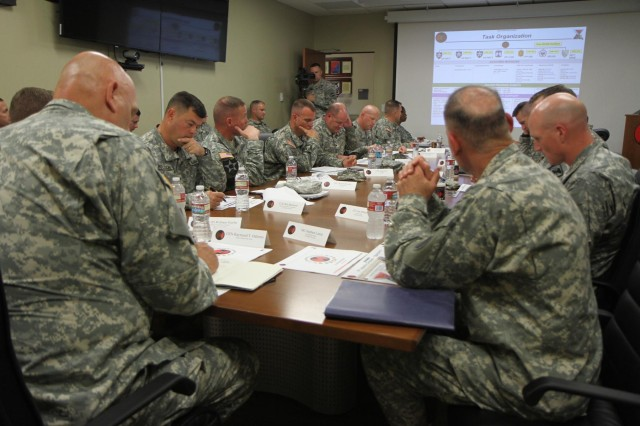 Chief of Staff of the U.S. Army Gen. Raymond T. Odierno, listens to a command briefing from seven brigade commanders and Maj. Gen. Stephen R. Lanza, 7th Infantry Division commanding general, at the division headquarter, Joint Base Lewis McChord, Wa., June 26, 2013.    (U.S. Army photo by Staff Sgt. Lindsey Kibler/Released)