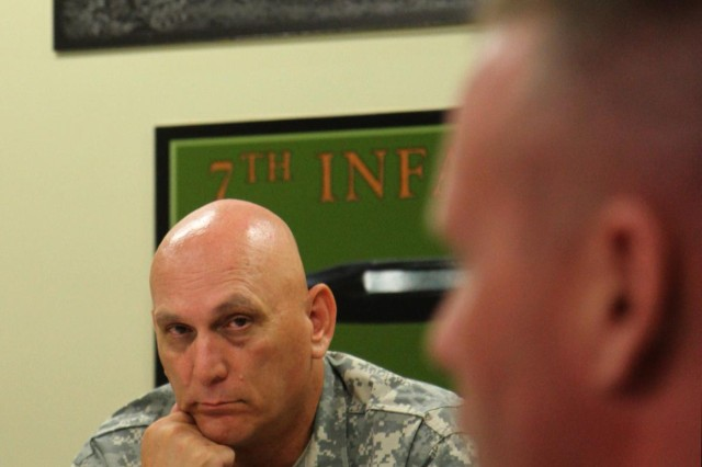 Chief of Staff of the U.S. Army Gen. Raymond T. Odierno, meets with Maj. Gen. Stephen R. Lanza, 7th Infantry Division commanding general, for a briefing on leader development, resiliency, training readiness, sustainment programs, and initiatives at the division headquarters,  Joint Base Lewis McChord, Wa., June 26, 2013.  (U.S. Army photo by Staff Sgt. Lindsey Kibler/Released)