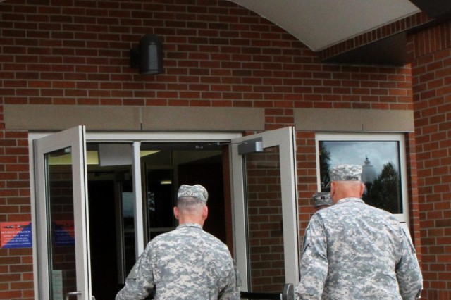Chief of Staff of the U.S. Army Gen. Raymond T. Odierno, right, walks into the 7th Infantry Division headquarters with Maj. Gen. Stephen R. Lanza, 7th Inf. Div. commanding general, for a briefing from brigade commanders at Joint Base Lewis McChord, Wa., June 26, 2013.  (U.S. Army photo by Staff Sgt. Lindsey Kibler/Released)