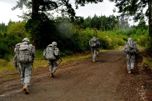 U.S. Army soldiers with 1st Squadron, 14th Cavalry Regiment, 3rd Brigade, 2nd Infantry Division, navigate their way to a testing station during a spur ride on Joint Base Lewis-McChord, Wash., June 26, 2013. The spur ride tested cavalry troopers' knowledge of weapons, land navigation, medical evacuation and cavalry heritage. (U.S. Army photo by Sgt. James Bunn, 17th Public Affairs Detachment/ Released)