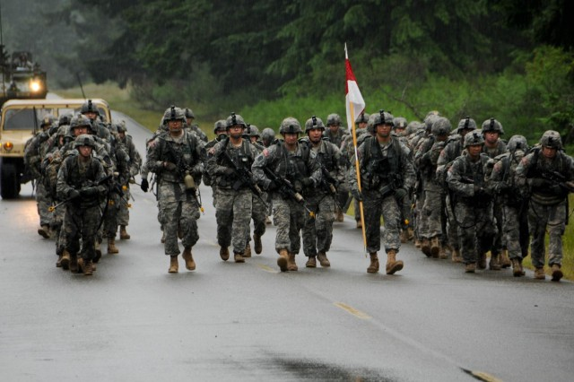 U.S. Army soldiers with 1st Squadron, 14th Cavalry Regiment, 3rd Brigade, 2nd Infantry Division, complete a 12-mile foot march during a spur ride at Joint Base Lewis-McChord, Wash., June 26, 2013. The spur ride tested cavalry troopers' knowledge of weapons, land navigation, medical evacuation and cavalry heritage. (U.S. Army photo by Sgt. James Bunn, 17th Public Affairs Detachment/ Released)