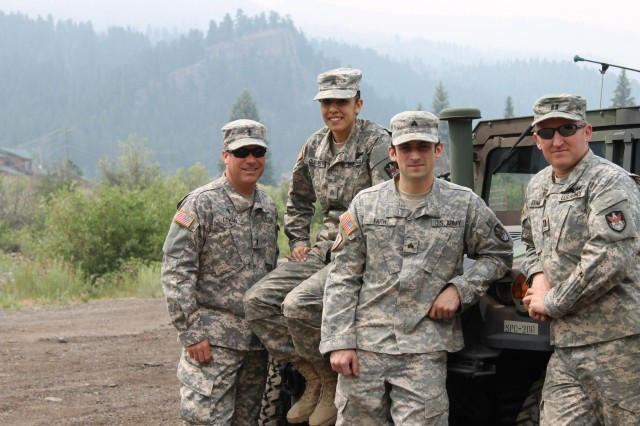 First Lt. Justin Cowan, chaplain, visits with 117th Space Battalion Guard members in the area of West Fork Complex fire Colorado National Guard operations, June 30, 2013.