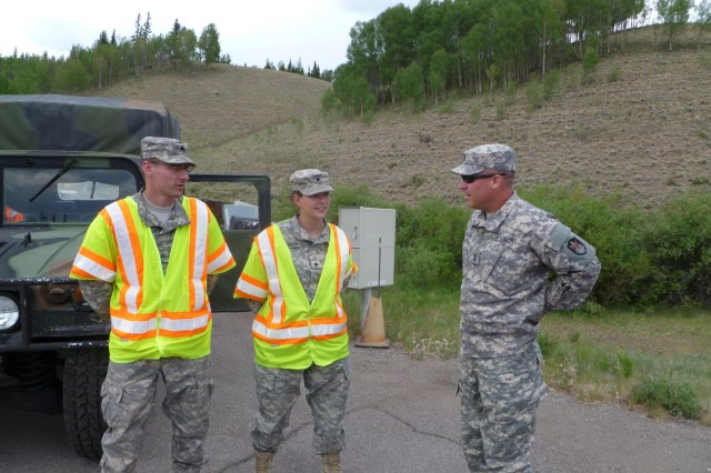 First Lt. Justin Cowan, chaplain, visits with Guard members in the area of West Fork Complex fire Colorado National Guard operations, June 30, 2013.