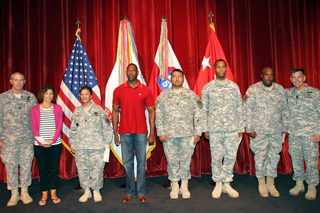 "FORT SAM HOUSTON, Texas. "" Command Sgt. Maj. Hu Rhodes (left) and Lt. Gen. William Caldwell IV (right) flank U.S. Army North (Fifth Army) Soldiers and civilians during the command's quarterly recognition ceremony and town hall meeting July 3 at the Fort Sam Houston Theater. The Army North members were recommended for honors as the command's 2013 volunteer of the year. Those nominated were: Tina Krompecher, wife of Lt. Col. Zoltan Krompecher, commander, Headquarters and Headquarters Battalion, Army North; Sgt. Maj. Linda Kessinger, noncommissioned officer-in-charge of U.S. Army North's personnel office; Tyrone Coleman, logistics; Master Sgt. Eric Espino, operations, plans and training; Sgt. First Class Varryron Young, Headquarters and Headquarters Battalion; and Sgt. Otha Wooley, HHBn. The 2013 volunteer of the year was Mike Snell (not pictured), who works in the Army North finance office. Caldwell is the commanding general of U.S. Army North (Fifth Army) and senior commander of Fort Sam Houston and Camp Bullis; Rhodes is his senior enlisted advisor."