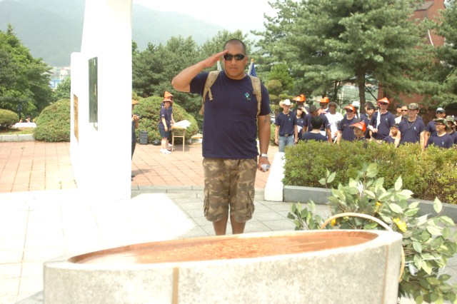 "DONGDUCHEON, South Korea "" Sgt. First Class Reynaldo L. Torres, 210th Fires Brigade network operations noncommissioned officer from Dallas, Texas, who is assigned to Headquarters and Headquarters Battery, renders a salute to fallen Soldiers who died during the Korea War at the Luxembourg War Monument June 6. The event commemorates the 60th Anniversary of the Armistice Agreement and to reinforce the Republic of Korea and U.S. alliance by allowing ROK civilians an opportunity to walk among the Soldiers who defend their liberty. Soldiers and civilians were able to visit Soyo Mountain, the Luxembourg War Monument, the Independence Patriots Memorial Stone, the Freedom Protection Peace Museum, and the Typhoon Observatory. (U.S. Army photo by Staff Sgt. Carlos R. Davis, 210th Fires Brigade public affairs NCO/Released)."