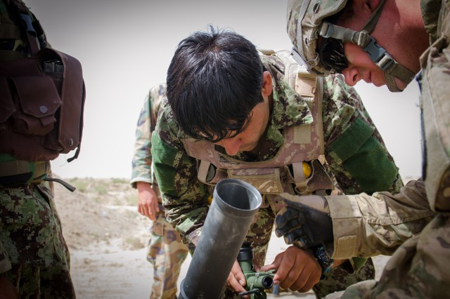 GHAZNI PROVINCE, Afghanistan - Soldiers from the 6th Khandak, 3rd Brigade, 203rd Corps Afghan National Army added 60mm mortar systems to their entourage of armaments and receive assistance from Soldiers of the 1st Battalion, 87th Infantry Regiment on how to operate their new equipment, 7 July 2013. The 6th Khandak mortarmen were already well-versed with firing systems of other variations; this light and highly mobile system allows them to shoot, move and communicate with improved haste. With the assistance of the 1-87 Infantry Soldiers, they were able to hit every target fo the day.  (Photo taken by U.S. Army Sgt. 1st Class Kenneth Foss)