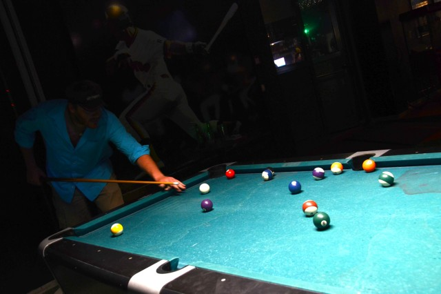 Jeff Carson shoots pool while listening to the soothing sounds of country karaoke.