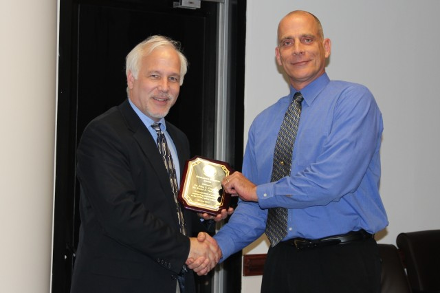 Joseph L. Corriveau, director of the Research and Technology Directorate at ECBC, presented the award to David McCaskey, engineering technician with the Operational Toxicology Branch. McCaskey was recognized alongside colleague John Carpin (not pictured), for their design of the McNamara Glove Box Facility.