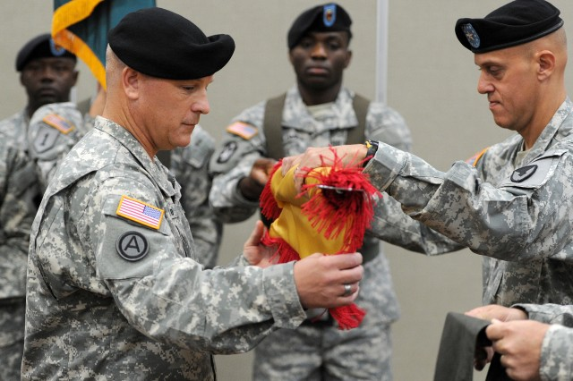 Col. Timothy Starostanko (left) and Brig. Gen. Kirk Vollmecke unfurl the colors of the 418th Contracting Support Brigade, during an activation and assumption-of-command ceremony, July 10, 2013, at the Community Events Center at Fort Hood, Texas. Starostanko assumed command of the 418th CSB, and Vollmecke is the commanding general of the Mission Installation Contracting Command at Joint Base San Antonio-Fort Sam Houston, Texas.