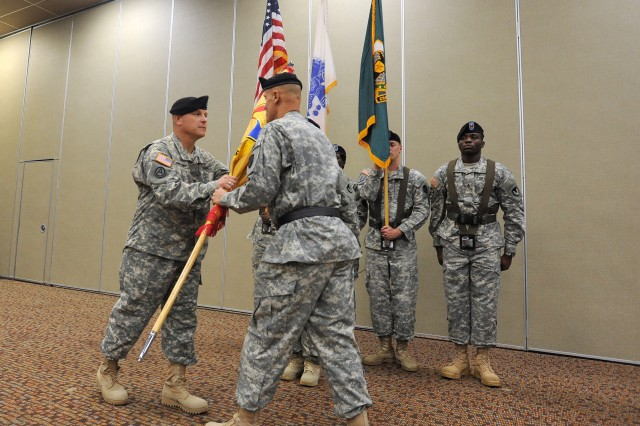 Col. Timothy Starostanko (left) accepts the 418th Contracting Support Brigade colors from Brig. Gen. Kirk Vollmecke to take command of the unit during an activation and assumption-of-command ceremony, July 10, 2013, at the Community Events Center at Fort Hood, Texas. Vollmecke is the commanding general of the Mission Installation Contracting Command at Joint Base San Antonio-Fort Sam Houston, Texas.