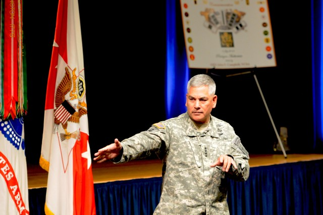 Vice Chief of Staff of the Army Gen. John F. Campbell points to those in the crowd during the ceremony celebrating the 95th birthday celebration of the Warrant Officer Corps.