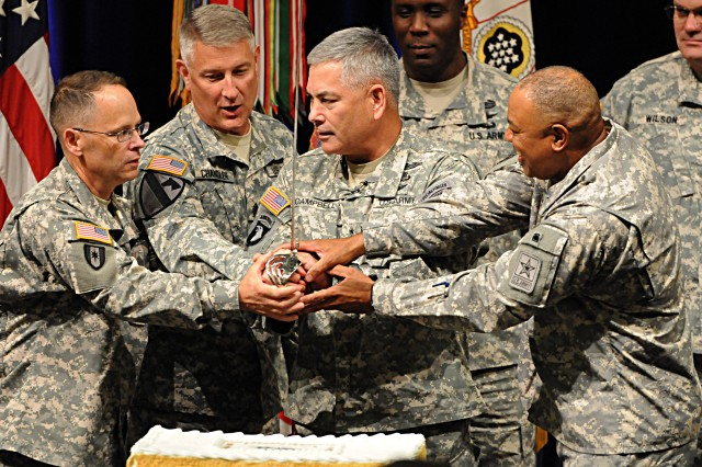 Sgt. Maj. of the Army Raymond F. Chandler III (center left) and Vice Chief of Staff of the Army Gen. John F. Campbell (center right), Army leaders and Warrant Officers prepare to cut the cake at the 95th birthday celebration of the Warrant Officer Corps.