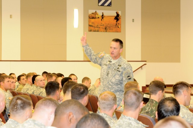 Gen. Dan Allyn, the commanding general of U.S. Army Forces Command, speaks to a group of students from the Maneuver Captains Career Course, July 1, 2013, at Derby Auditorium on Fort Benning, Ga.