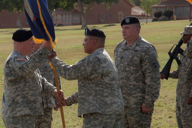 "The U.S. Army Test and Evaluation Command Commanding General Maj. Gen. Genaro J. Dellarocco receives the ""colors,"" representing the U.S. Army Electronic Proving Ground, from outgoing Commander Col. Ronald Jacobs Jr., signifying the passing of command July 9. Headquartered at Fort Huachuca, USAEPG's mission is to plan, conduct, analyze, evaluate and report the results of developmental and operational tests and evaluations in support of network, electronic warfare and command, control, communications, computers, intelligence, surveillance and reconnaissance systems customers."