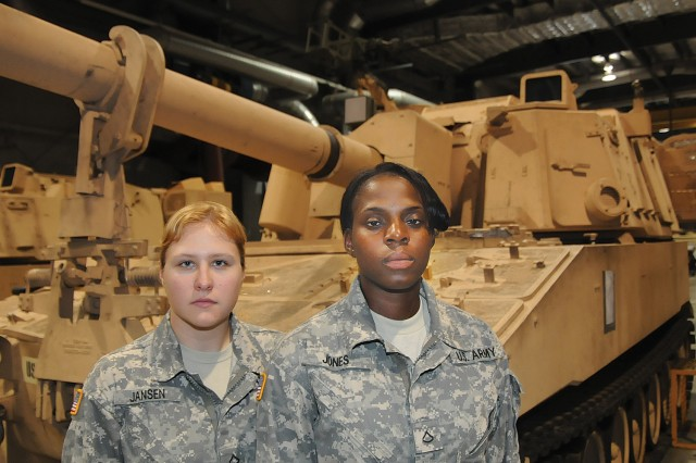 Pfc. Angelika Jansen and Pfc. Jessica Jones stand near a Paladin M109 self-propelled howitzer at Vincent Hall on Fort Lee, Va., July 3, 2013. The two Soldiers, who were awarded the Artillery Mechanic military occupational specialty, or MOS, were the first two females to earn the designation. The MOS was one of six that were chosen last year to open its ranks to female Soldiers. The Department of Defense has a goal to make all MOSs open to female applicants by 2016.
