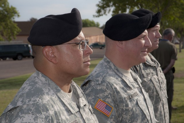 From left, Col. Ronald Jacobs, outgoing U.S. Army Electronic Proving Ground commander, Jr. stands with Maj. Gen. Genaro Dellarocco, commanding general for the Army Test and Evaluation Command, and Col. Raymond Compton, incoming EPG commander, before the U.S. Army Electronic Proving Ground change of command ceremony on Brown Parade Field Tuesday.