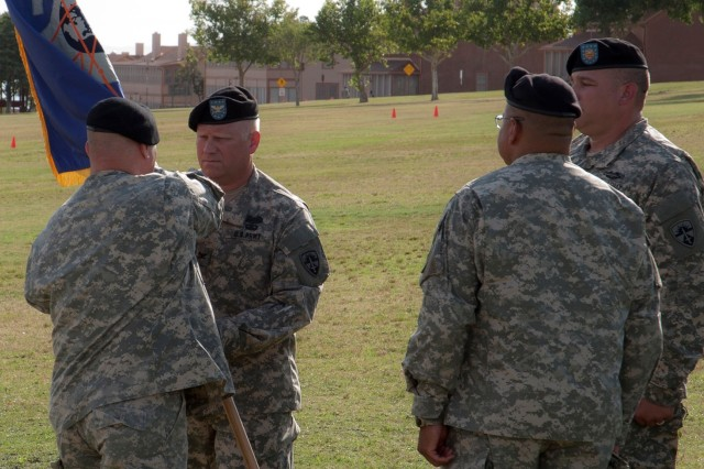 """Maj. Gen. Genaro Dellarocco, the U.S. Army Test and Evaluation Command commanding general, passes command and the """"colors,"""" representing the U.S. Army Electronic Proving Ground to Col. Raymond Compton Tuesday on Brown Parade Field. Headquartered at Fort Huachuca, USAEPG's mission is to plan, conduct, analyze, evaluate and report the results of developmental and operational tests and evaluations in support of network, electronic warfare and command, control, communications, computers, intelligence, surveillance and reconnaissance systems customers."""