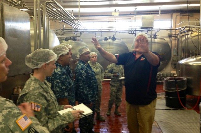 Mr. Doug Sheehan explains the quality control process for all dairy products processed by Meadow Gold.