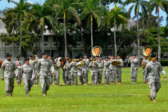 Col. Scott Baer, Brig. Gen. Janie Haigler and Col. Cleophus Thomas conduct pass and review during the 516th Signal Brigade Change of Command ceremony on historic Palm Circle, here, July 3.
