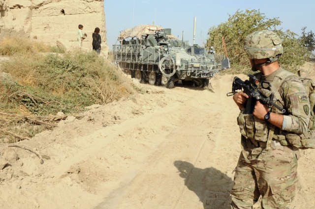The Army's Project Manager Stryker Brigade Combat Team took the first steps in retrograding their equipment from Operation Enduring Freedom when it accepted the final repaired Stryker from its forward deployed Battle Damage Repair facility in Qatar. Picture here, a Stryker vehicle rounds a corner in a Taloqan district village, Takhar Province, Afghanistan, Oct. 22, 2011, as Spc. Josh Bates, a medic with 3rd Battalion, 21st Infantry Regiment, 1st Stryker Brigade Combat Team, 25th Infantry Division, keeps watch.