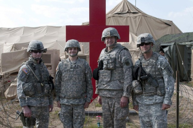 From left to right: Col. Tim Lawson, 32nd Infantry Brigade Combat Team commander; 1st Lt. Christopher Mohr, newly appointed chaplain for the 32nd Brigade Special Troops Battalion; Col. Douglas Fleischfresser, the state command chaplain; and Maj. John Reiter, the 32nd BSTB commander, following a July 10 ceremony at Fort McCoy, Wis. Mohr became the first Buddhist chaplain in the Wisconsin Army National Guard. (112th Mobile Public Affairs Detachment photo by Staff Sgt. Megan Burnham)