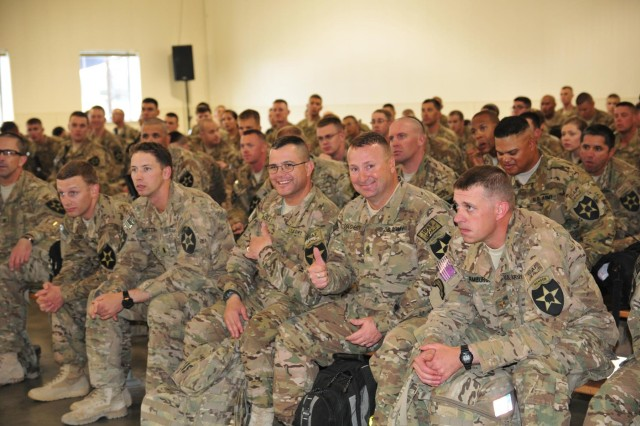 Sgt. Maj. Daniel Adle and Sgt. Maj. David Dougherty, both with 4th Stryker Brigade Combat Team, 2nd Infantry Division, give a thumbs-up while waiting for an in-processing brief July 10 at the passenger terminal on Joint Base Lewis-McChord, Wash. Dougherty, Adle and approximately 230 4th SBCT soldiers returned home after an eight-month deployment to Afghanistan in support of Operation Enduring Freedom. (U.S. Army photo by Sgt. Kimberly Hackbarth, 4th SBCT, 2nd ID Public Affairs Office)