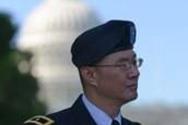 Brig. Gen. (Dr.) John M. Cho, deputy chief of staff for Operations (G-3/5/7), Army Medical Command, addresses the issue of post-traumatic stress disorder and traumatic brain injury, on Capitol Hill, June 22.
