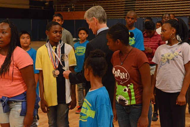 Secretary of the Army John McHugh interacts with a platoon of District of Columbia National Guard Youth Leaders Camp members at the (Washington) D.C. Armory, July 12, 2013. McHugh also met with National Guard Soldiers and Airmen during his visit.