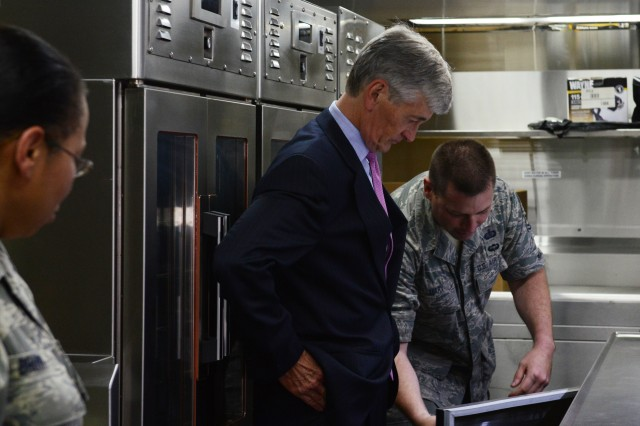 Secretary of the Army John McHugh meets with Soldiers and Airmen of the District of Columbia National Guard at the (Washington) D.C. Armory, July 12, 2013. Here, he tours a Disaster Relief Mobile Kitchen Trailer during a visit with troops in the motor pool. McHugh directed a mobilization of the D.C. Guard during Hurricane Sandy.